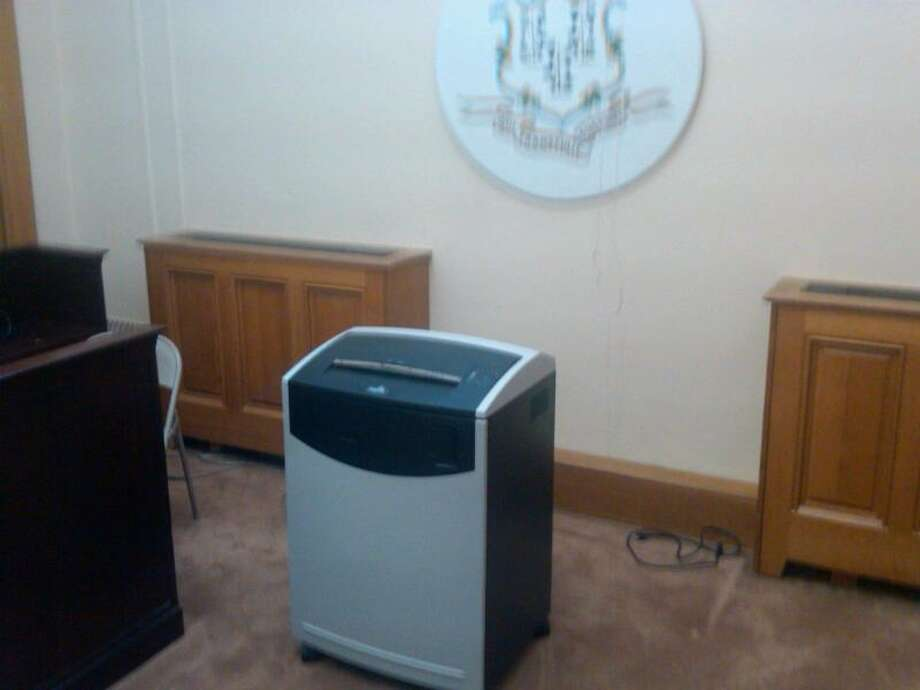 An office-sized paper shredder in the basement of the state Capitol in 2010. The state's Freedom of Information Act makes public employee personnel files available to the public, and for good reason. These files contain documents that not only outline allegations of misconduct, but they also detail the manner in which supervisors respond. Photo: File Photo / Connecticut Post