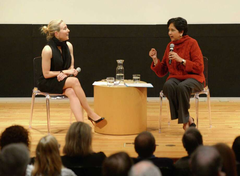 State Sen. Alex Bergstein, D-Greenwich, left, and PepsiCo Chairman Indra Nooyi speak during the Community Conversation at Greenwich Library's Cole Auditorium in Greenwich, Conn. Thursday, Jan. 24, 2019. The two discussed how to attract and retain businesses in Connecticut as a small group protested the proposal of tolls outside the event. Photo: Tyler Sizemore / Hearst Connecticut Media / Greenwich Time