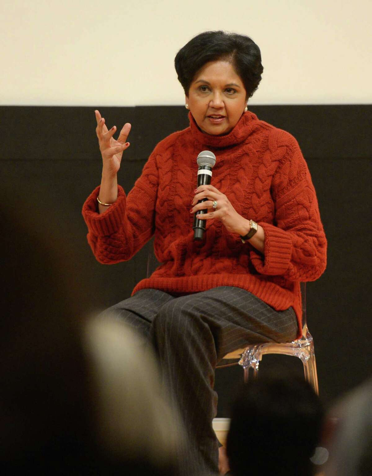 PepsiCo Chairman Indra Nooyi speaks during the Community Conversation featuring State Sen. Alex Bergstein and PepsiCo Chairman Indra Nooyi at Greenwich Library's Cole Auditorium in Greenwich, Conn. Thursday, Jan. 24, 2019. The two discussed how to attract and retain businesses in Connecticut as a small group protested the proposal of tolls outside the event.