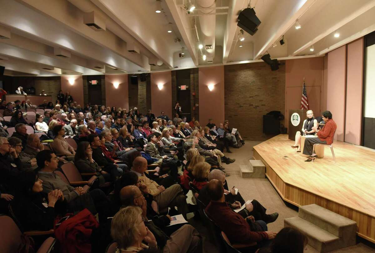 A full auditorium attends the Community Conversation featuring State Sen. Alex Bergstein and PepsiCo Chairman Indra Nooyi at Greenwich Library's Cole Auditorium in Greenwich, Conn. Thursday, Jan. 24, 2019. The two discussed how to attract and retain businesses in Connecticut as a small group protested the proposal of tolls outside the event.