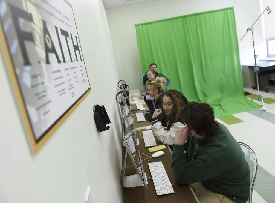 Students work in the sophomore media class in the new upstairs wing at Trinity Catholic High School in Stamford in January. Renovation of the upstairs and downstairs high school wings, as well as a new guidance office addition, have been completed. Phase three, construction of the Catholic Academy Upper School wing, is in progress and expected to be completed by April. Photo: Tyler Sizemore / Hearst Connecticut Media / Greenwich Time
