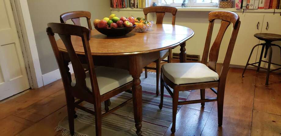 A new fabric and some staples helped Deanna Fox refresh the dining room chairs around the table in her home. (Photo by Deanna Fox)