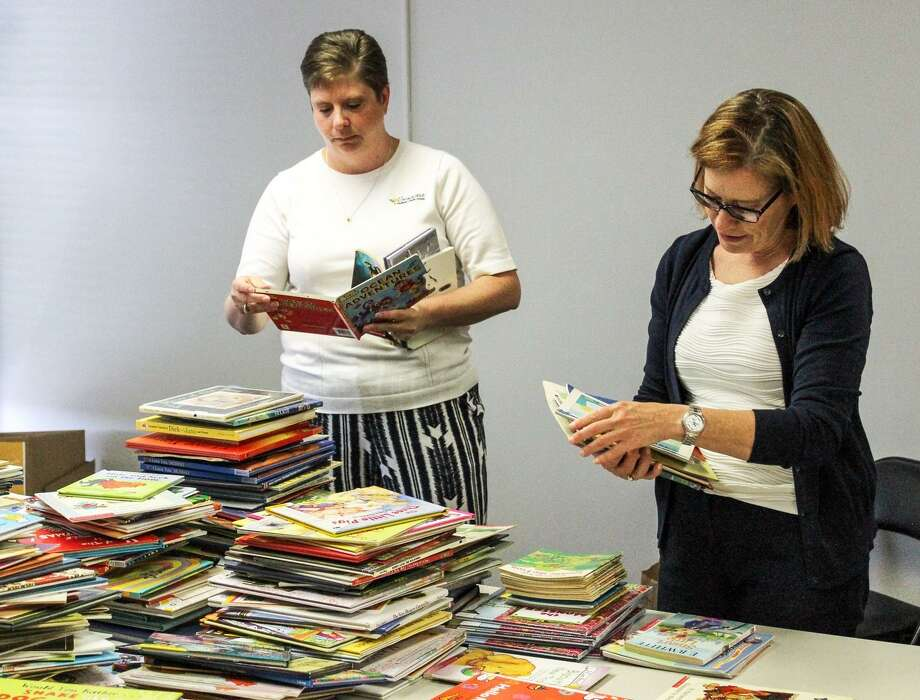Well over 2,000 books were collected during the Middlesex United Way's first Day of Action Community-Wide Book Drive June 21. This year, the focus was collecting books to help elementary students enhance their reading abilities, and meet or exceed grade-level expectations. Photo: Contributed Photo