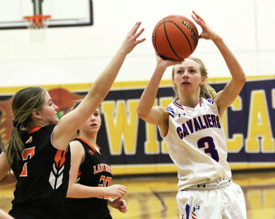 Carlinville's Rachel Olroyd (right) shoots over the hand of Gillespie's Hannah Barrett during a Macoupin County Tournament semfinal last week in Mount Olive. The Cavaliers and Miners met again Thursday night in Carlinville and Olroyd scored 18 points to get to 1,000 for her career in the Cavs' win. Photo: Greg Shashack / The Telegraph