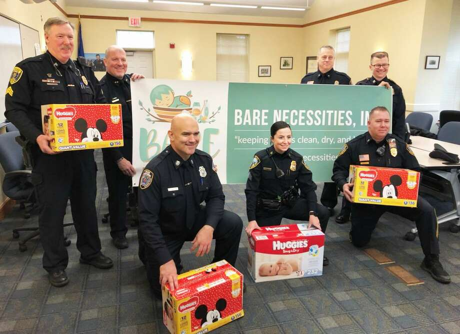 The Clinton, Branford, Guilford and Madison police departments, along with Connecticut State Police in Westbrook, have begun the annual Shoreline Diaper Drive. Shown are (from left, back row) Sgt. Jeremiah Dunn, Clinton Police Chief Vincent DeMaio, Guilford Police Deputy Chief Warren Hyatt and Madison Capt. Joseph Race. In the front row are Madison Officer Douglas Harkins, Branford Sgt. Corianne Dionne and Guilford Lt. Timothy Bernier. Photo: Contributed Photo