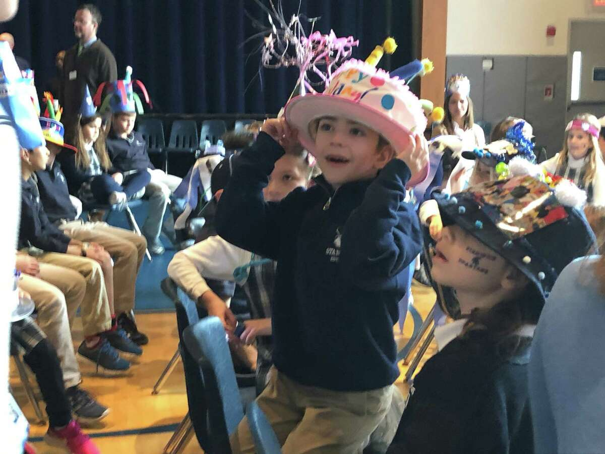 Stanwich Lower School students go all out with their birthday hats celebrating the school receiving its charter 21 years ago. This is the last charter day the school will celebrate before it merges with Greenwich Country Day School.