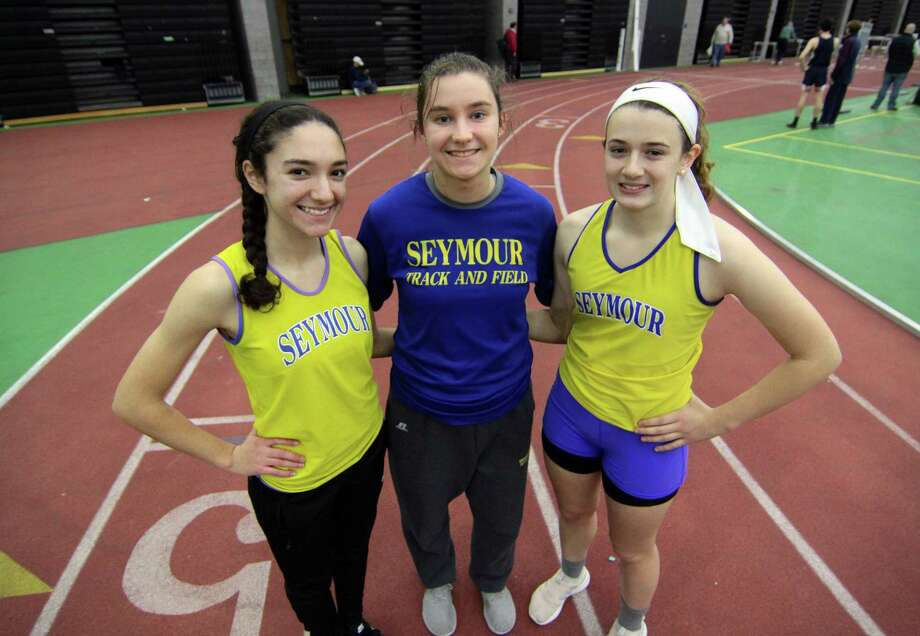 Seymour High School indoor track team members Amber Recine, left, Patty Jurkowski, center, and McKenzie Collins. Photo: Christian Abraham / Hearst Connecticut Media / Connecticut Post