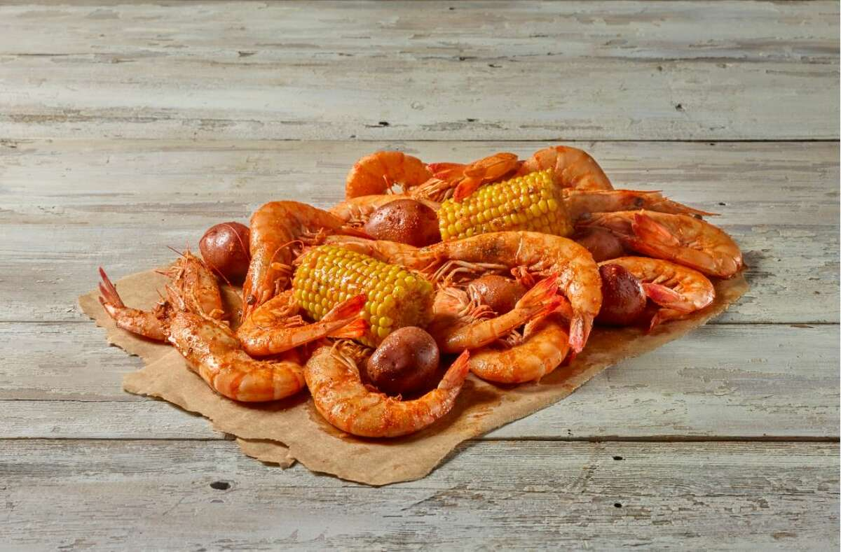 Jumbo head-on Gulf shrimp with seasoned corn and potatoes at True Texas Boil House.