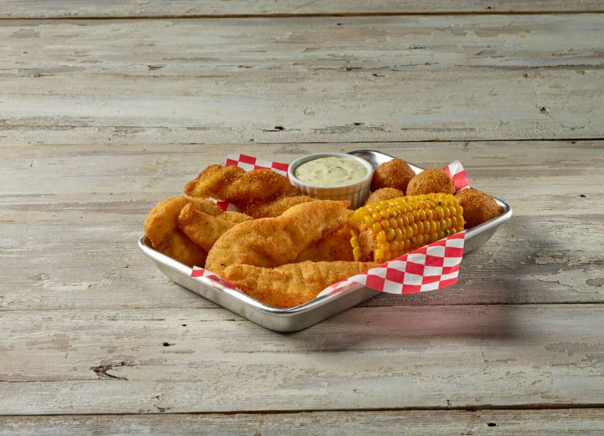 Fried Catfish Basket with Southern hush puppies and seasoned corn at True Texas Boil House.