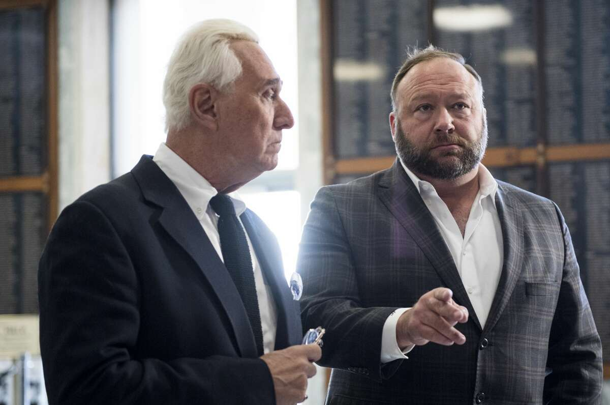 UNITED STATES - DECEMBER 11: Roger Stone, left, and Alex Jones hold a press conference before attending the House Judiciary Committee's hearing on
