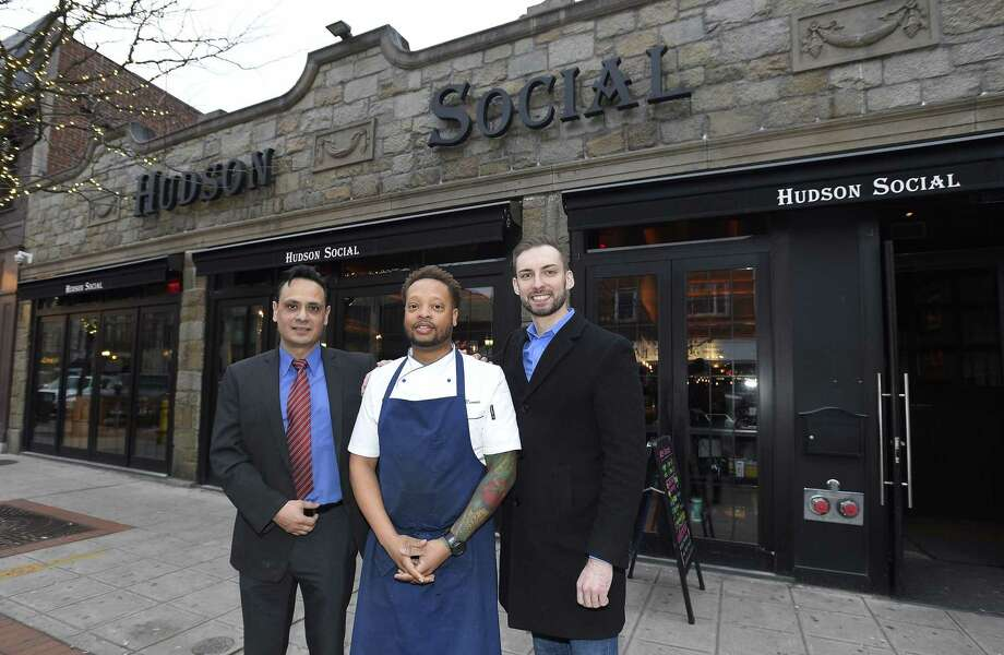 From left, co-manager Miguel Sanchez, Executive Chef Vincent Rennie and co-manager Michael Slocum stand outside the new Hudson Social restaurant at 128 Bedford St., in downtown Stamford, Connecticut, on Wednesday, Jan. 23, 2019. Photo: Matthew Brown / Hearst Connecticut Media / Stamford Advocate