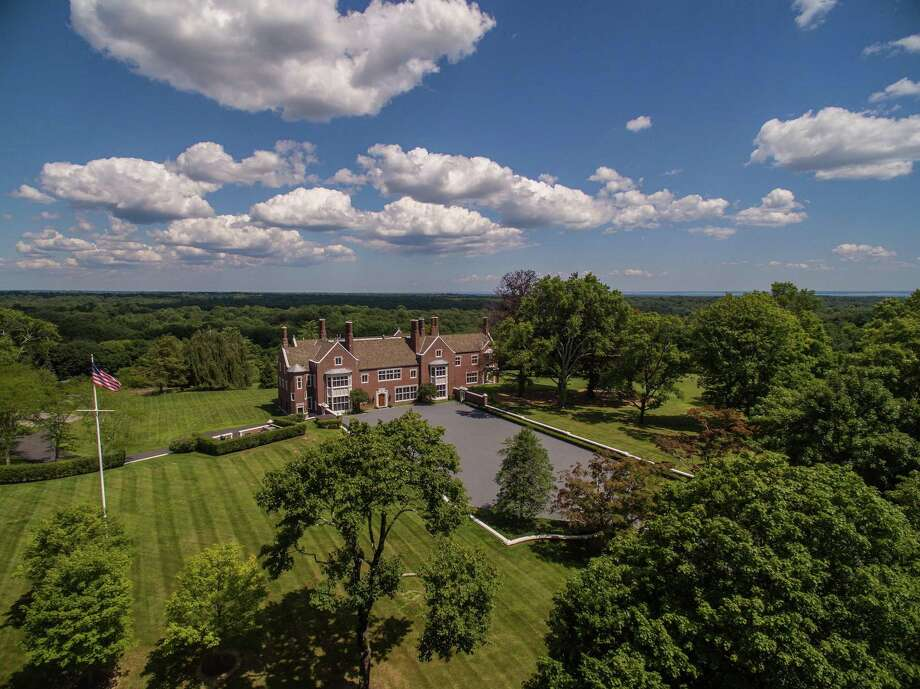 Round Hill Manor, at 521 Round Hill Road, in Greenwich, Conn., is now listed for $22.5 million. Photo: Contributed Photo / © SR Photo, LLC All Rights Reserved