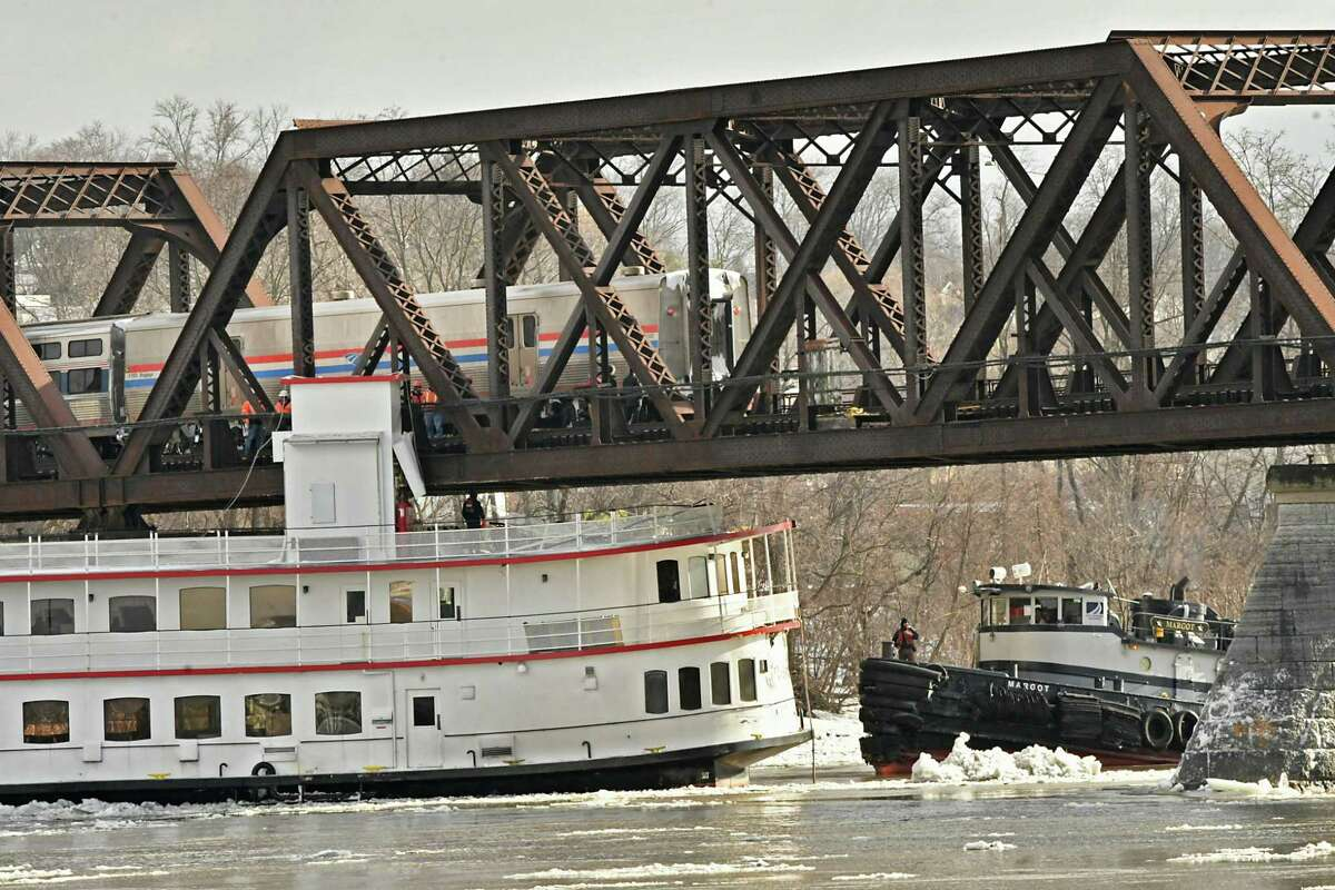 A tugboat is seen near the Captain JP lll boat which is stuck under the railroad bridge near the Corning Preserve on the Hudson River on Friday, Jan. 25, 2019 in Albany, N.Y. (Lori Van Buren/Times Union)