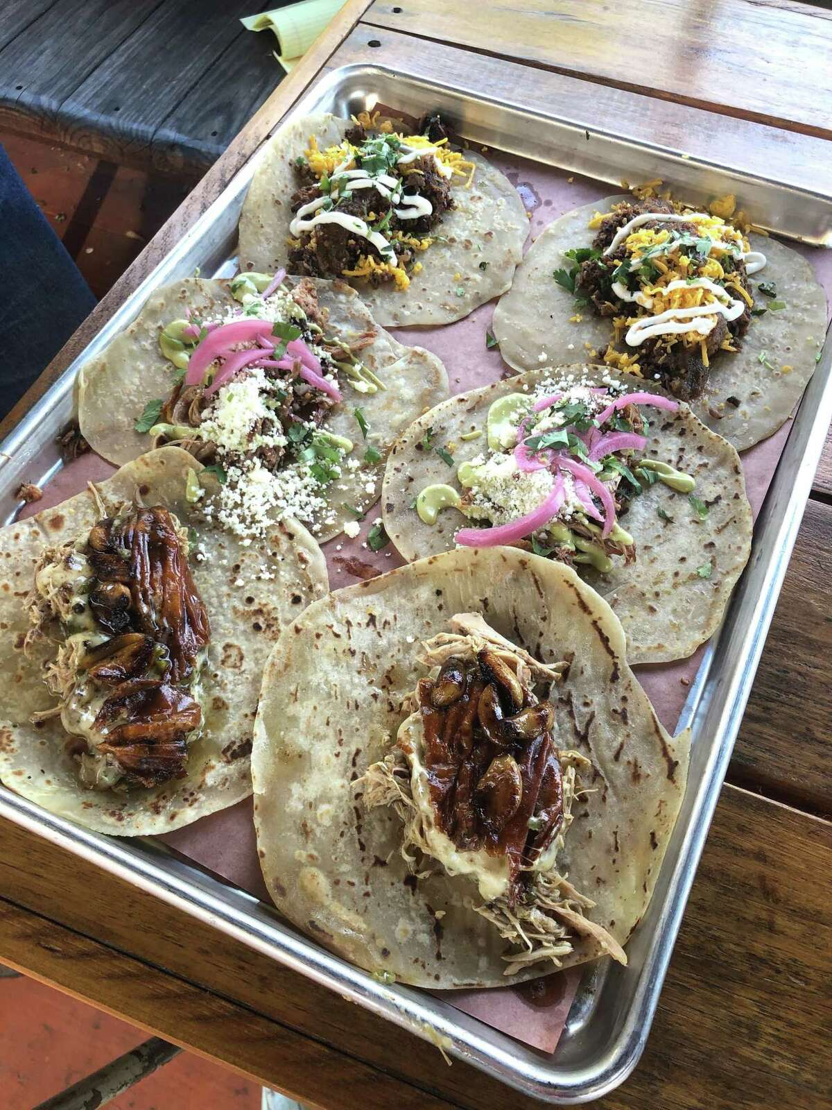 Brisket, pulled pork and shredded chicken tacos at The Pit Room