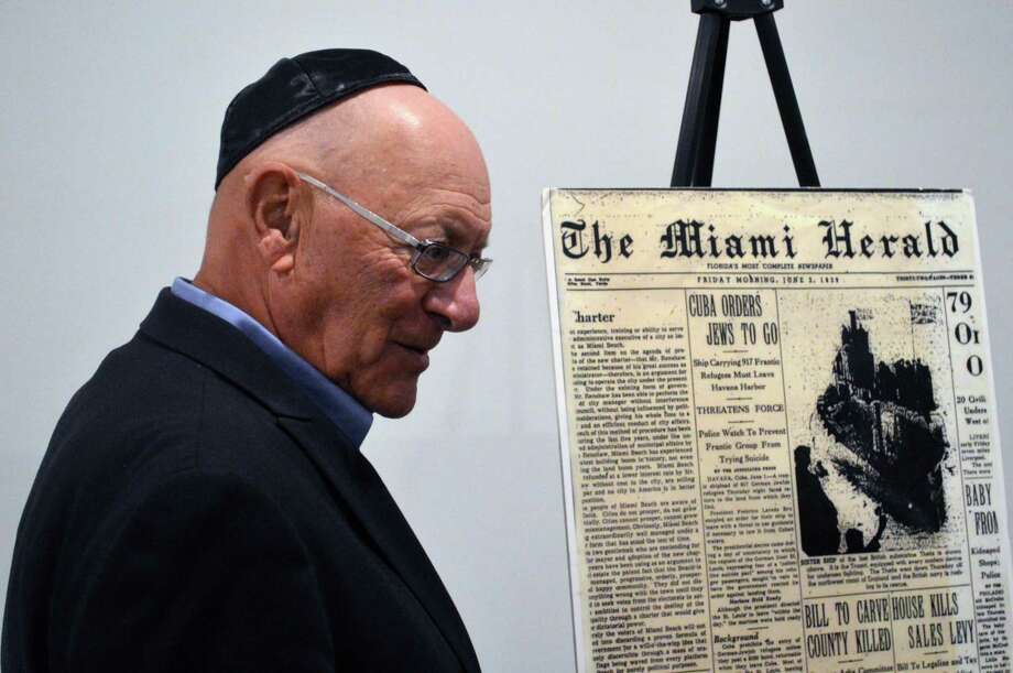 "Creator and producer Robert Krakow stands by an old news clipping at the screening of ""Complicit,"" a documentary on the S.S. St. Louis, and a question-and-answer session that included two survivors, Thursday, Jan. 24, 2019, at Chabad Lubavitch of Westport, in Westport, Conn. Photo: Jarret Liotta / For Hearst Connecticut Media / Westport News Freelance"