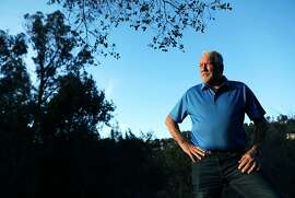 """Mel Copland, a broker with Alain Pinel Realtors, poses for a portrait near his vacant lot on Oakwood Court in Montclair, Calif., on Wednesday, January 23, 2019. Oakland has a new tax on vacant properties. Starting this year, any property in Oakland that is used less than 50 days a year will be subject to a tax. This includes commercial, residential and raw land. There are some exceptions, such as for very low income people. The city sent a letter to property owners who may be subject to the tax and many are confused and upset. """"I hope there's a class action lawsuit to stop this,"""" said Copland, 71. """"To be fair, I don't think they should take on an individual group of people to support the city of Oakland. If the voters vote on it, the whole city should pay for it. It should not be just people with vacant lots. You're taking on people, you know, had these lots for 30 some odd years. It's not fair."""""""