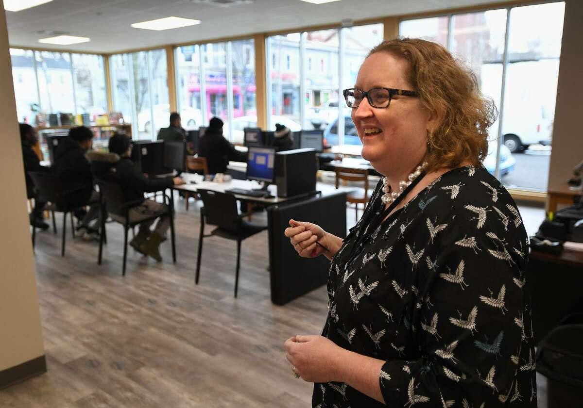 Branch librarian Jodi Weisz gives a tour of the new East Side Branch Library, featuring floor to ceiling windows, at 1174 East Main Street in Bridgeport, Conn. on Wednesday, January 23, 2019.