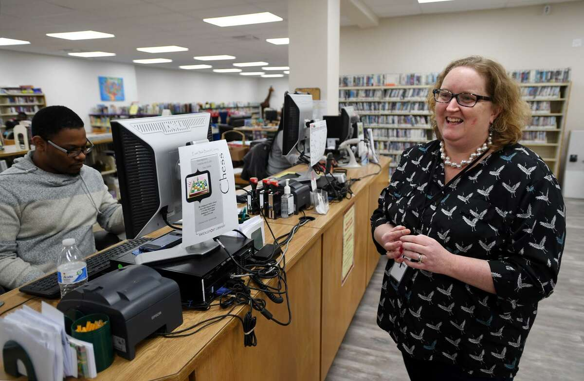 Branch librarian Jodi Weisz gives a tour of the new East Side Branch Library at 1174 East Main Street in Bridgeport, Conn. on Wednesday, January 23, 2019.