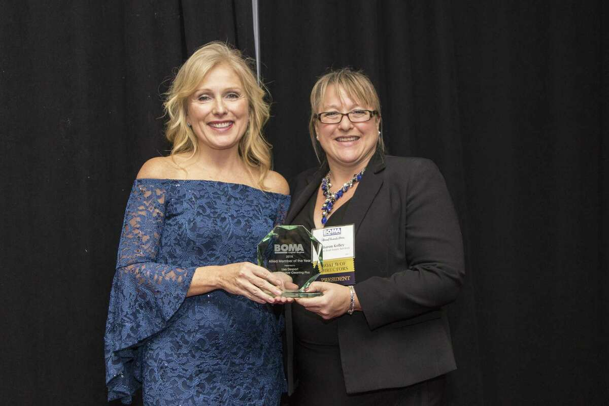 Lisa Despart, left, President of AWCplus, was recently recognized as Allied Member of the Year for Capital Region BOMA (Building Owners and Managers Association). At right is BOMA President Sharon Kelley. (Photo provided)