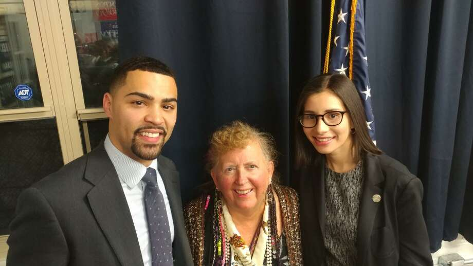 New Haven attorney Erick Russell, left, was named vice chair of Connecticut's Democratic State Central Committee, Audrey Blondin of Litchfield was re-elected as secretary, and Norwalk City Councilwoman Eloisa Melendez was chosen as treasurer on Jan. 23. Photo: Contribtued Photo
