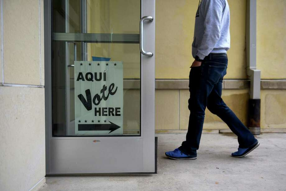 A resident arrives for early voting at a polling location in San Antonio, Texas, U.S., on Monday. Oct. 22, 2018.