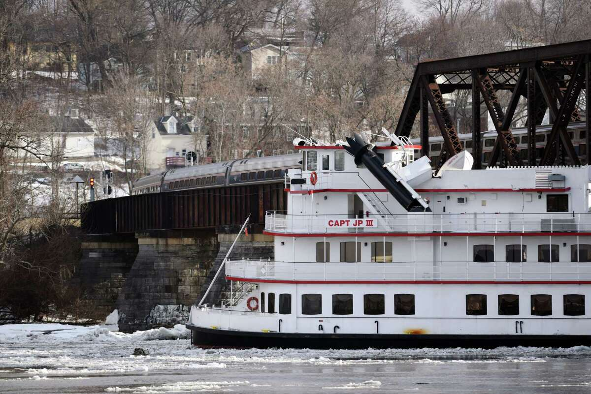 An Amtrak train slowly clears the Livingston Avenue Train Bridge where the The Captain JP III is stuck under on the Hudson River near the Corning preserve on Friday, Jan. 25, 2019 Friday, Jan. 25, 2019 in Albany, N.Y. (Phoebe Sheehan/Times Union)