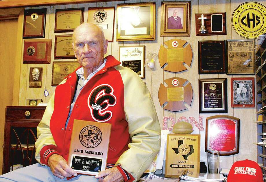 Don E. Granger, 90, is pictured at his Granger Hardware Store in Grangerland among his vast collection of sports and history memorabilia at his store. Granger started coaching in 1957 and retired from teaching school in 1985 at Conroe High School. Granger passed away at 90 Monday morning. Photo: HCN File Photo