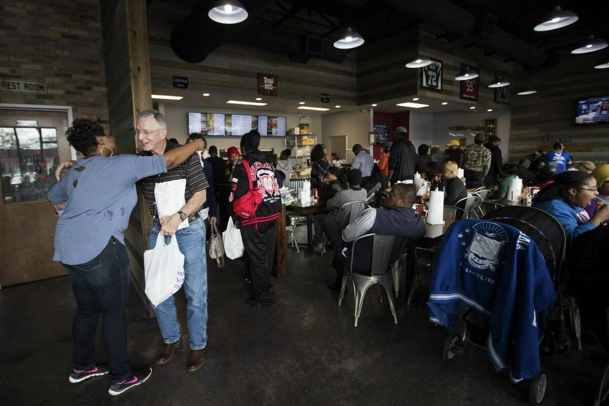 Gary Priest, a furloughed NASA engineer thanks Stephanie Bolton who works for Ray's BBQ Shack on his way out after picking up food at the establishment. The bbq restaurant announced that from 1 p.m. to 4 p.m. on Monday, Jan. 21, 2019, in Houston, furloughed federal workers are welcomed to pick up a meal for free.