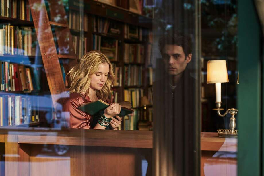"Elizabeth Lail and Penn Badgley appear in a scene from ""You"" on Netflix. Photo: Netflix"