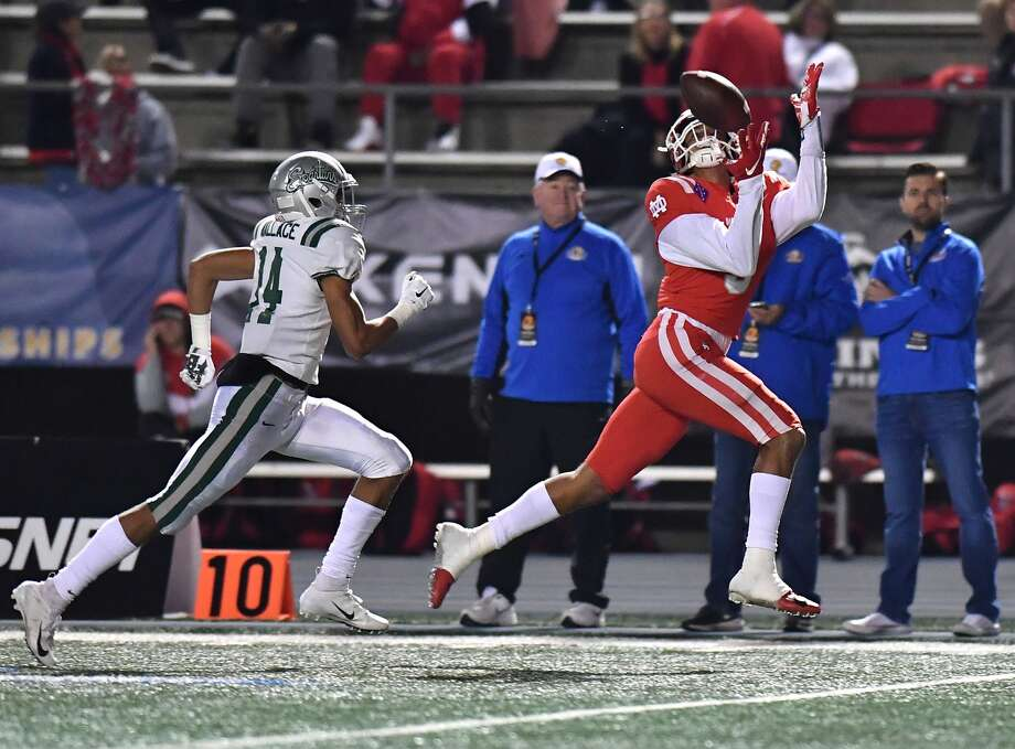 December 8, 2018 Cerritos, CA.  Mater Dei Bru Mccoy #5 catches the pass and runs in for the touchdown in front of Concord De La Salle Amir Wallace #14 in the second quarter in action during the CIF State Open Division prep football championship game.  CIF State Open Division Prep Football Championship. Mater Dei vs. Concord De La Salle Mandatory Photo Credit: Louis Lopez/Modern Exposure Photo: Louis Lopez/Louis Lopez/Modern Exposure