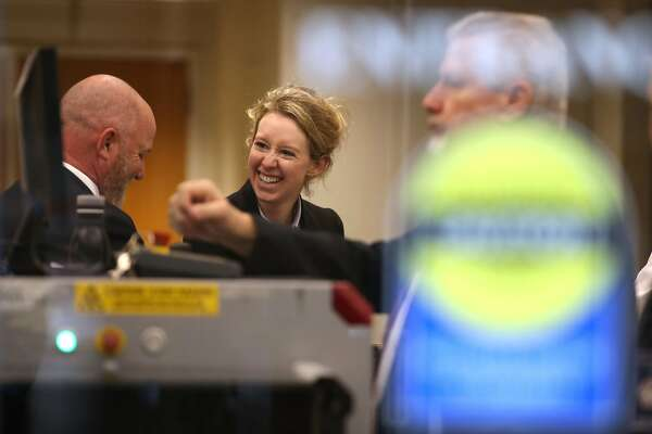 SAN JOSE, CALIFORNIA - JANUARY 14: Former Theranos founder and CEO Elizabeth Holmes goes through security as she arrives at the Robert F. Peckham U.S. Federal Court on January 14, 2019 in San Jose, California. Former Theranos CEO Elizabeth Holmes and former COO Ramesh Balwani appeared in federal court facing charges of conspiracy and wire fraud for allegedly engaging in a multimillion-dollar scheme to defraud investors with the Theranos blood testing lab services. (Photo by Justin Sullivan/Getty Images)