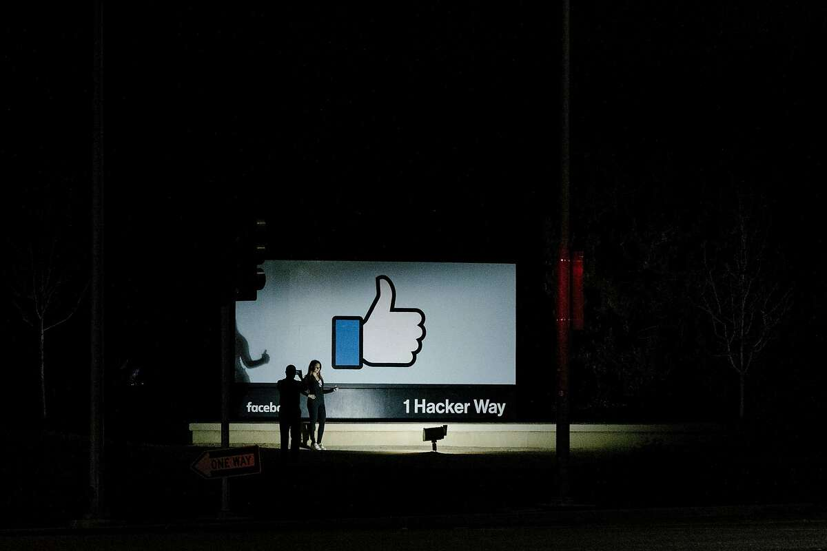 FILE -- A woman poses for a photo at the Facebook campus in Menlo Park, Calif., on April 9, 2018. Facebook plans to integrate the technical infrastructure for WhatsApp, Instagram and Facebook Messenger as Mark Zuckerberg, the company's chief executive, asserts control over all of the apps. (Jason Henry/The New York Times)