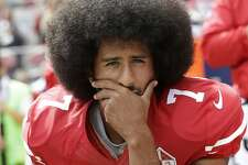 FILE - In this Oct. 2, 2016, file photo, then-San Francisco 49ers quarterback Colin Kaepernick kneels during the national anthem before an NFL football game against the Dallas Cowboys, in Santa Clara, Calif. Ex-NFL player Colin Kaepernick helped start a wave of protests by kneeling during the national anthem to raise awareness to police brutality, racial inequality and other social issues. Big-name entertainers believe social injustice needs to be addressed during the Super Bowl and are ensuring the topic that ignited a political firestorm and engulfed the NFL will be in the spotlight. (AP Photo/Marcio Jose Sanchez, File)