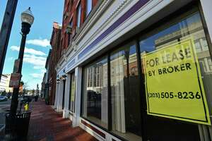Storefronts along Washington St. Friday, January 25, 2019, in Norwalk, Conn. Norwalk has three Opportunity Zones that are meant to lure investors into town, to hopefully breathe life into projects in need of funding, while receiving tax benefits for their investments.