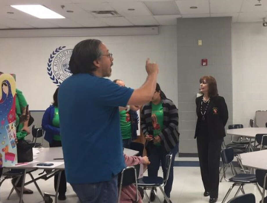 An upset parent asks questions after the Diocese of Laredo announced that it had decided to close Our Lady of Guadalupe and St. Peter's Memorial schools. The two schools will be consolidated into one at Our Lady of Guadalupe, which will be renamed. Photo: Laredo Morning Times