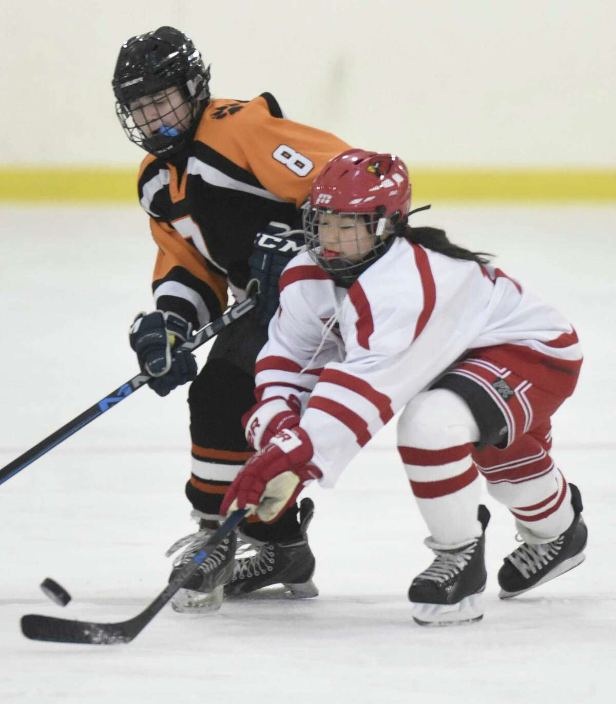 Greenwich's Emiri Fukuchi, right, battles for the puck with Ridgefield/Danbury's Emily Stefanelli during a game on Jan. 29, 2018 at Dorothy Hamill Rink in Greenwich.