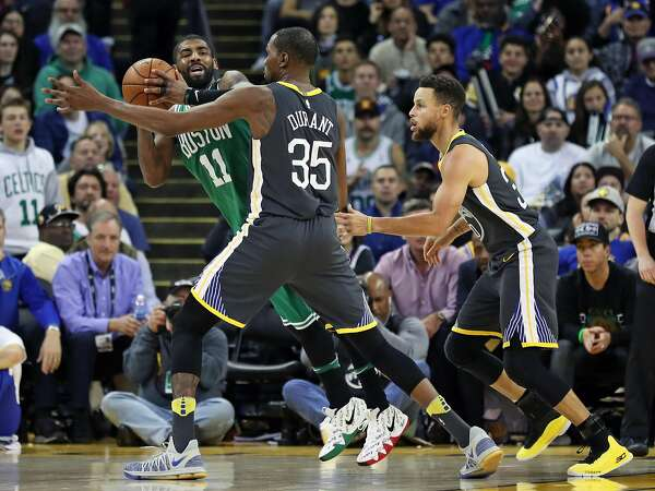 Golden State Warriors  Kevin Durant and Stephen Curry guard Boston Celtics   Kyrie Irving in 4th quarter during Warriors  109-105 win in NBA game at  Oracle ... 1e47f018f
