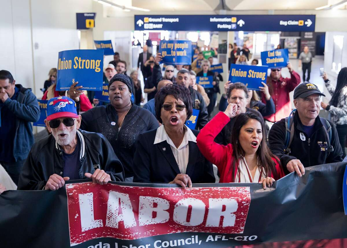 (From left) Bud Beal, Yvonne Williams and Liz Ortega lead furloughed federal workers and supporters on a march through Terminal 1 at the Oakland International Airport in Oakland, Calif. Friday, Jan. 25, 2019 after the government shutdown has forced federal workers to miss their second paycheck.
