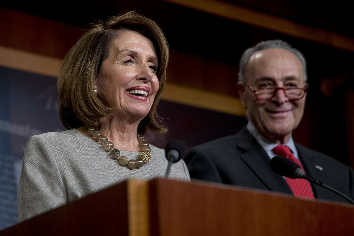 House Speaker Nancy Pelosi of Calif., and Senate Minority Leader Sen. Chuck Schumer of N.Y., smile during a news conference on Capitol Hill in Washington, Friday, Jan. 25, 2019, after President Donald Trump announces a deal to reopen the government for three weeks.