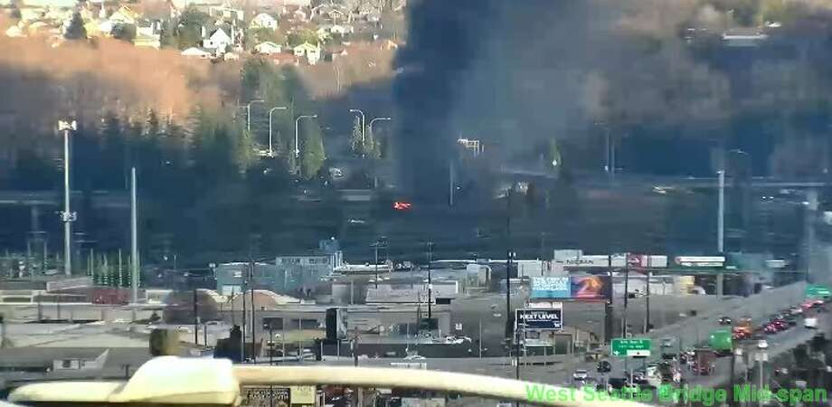 A charter bus fire blocked all northbound lanes of Interstate 5, Friday afternoon. Photo: Seattle Department Of Transportation