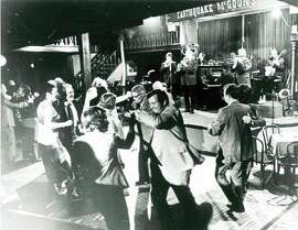 The dance floor is full of patrons dancing to the sounds of the Turk Murphy Jazz Band, playing at Earthquake McGoon's at 630 Clay Street in San Francisco, circa 1973.