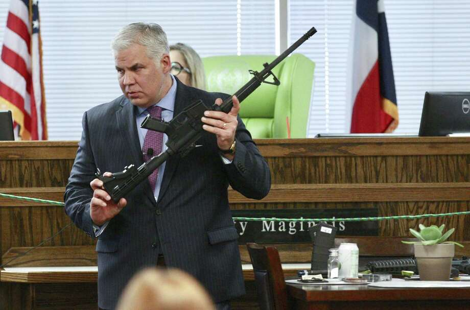 Montgomery County District Attorney Brett Ligon discusses evidence with an expert during the murder trial of Rafael Leos-Trejo in the 435th state District Court Judge Patty Maginnis at the Lee G. Alworth Building, Friday, Jan. 25, 2019, in Conroe. Trejo, of Spring, is charged with shooting and killing his wife Jessica Torres Leos. Photo: Jason Fochtman, Houston Chronicle / Staff Photographer / Houston Chronicle 2019