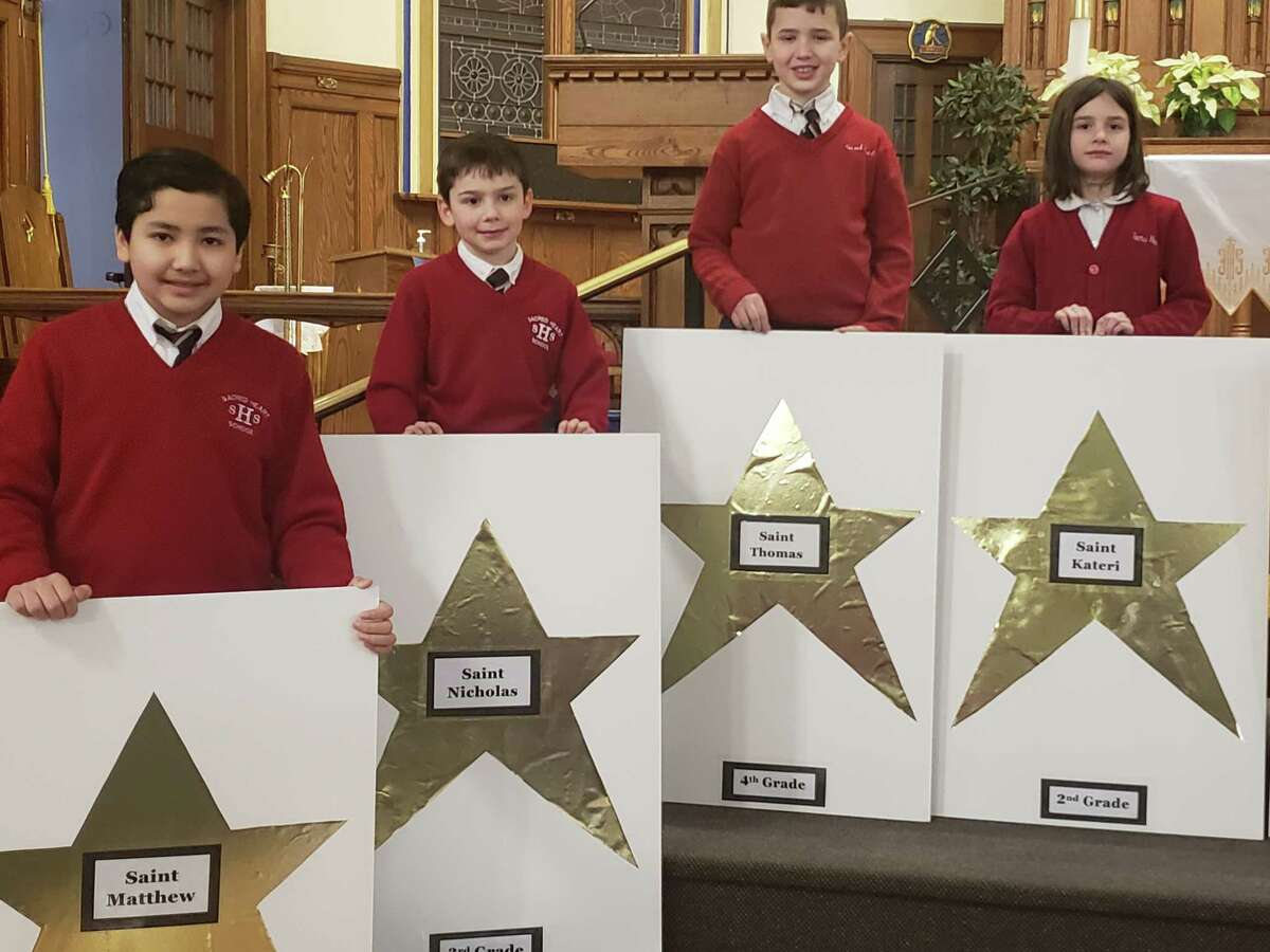 Sacred Heart School students selected their stars for our Catholic Schools opening ceremonies on Monday. Each star highlights the name of a saint that the children at the Troy school will be studying. (Karen Snyder)