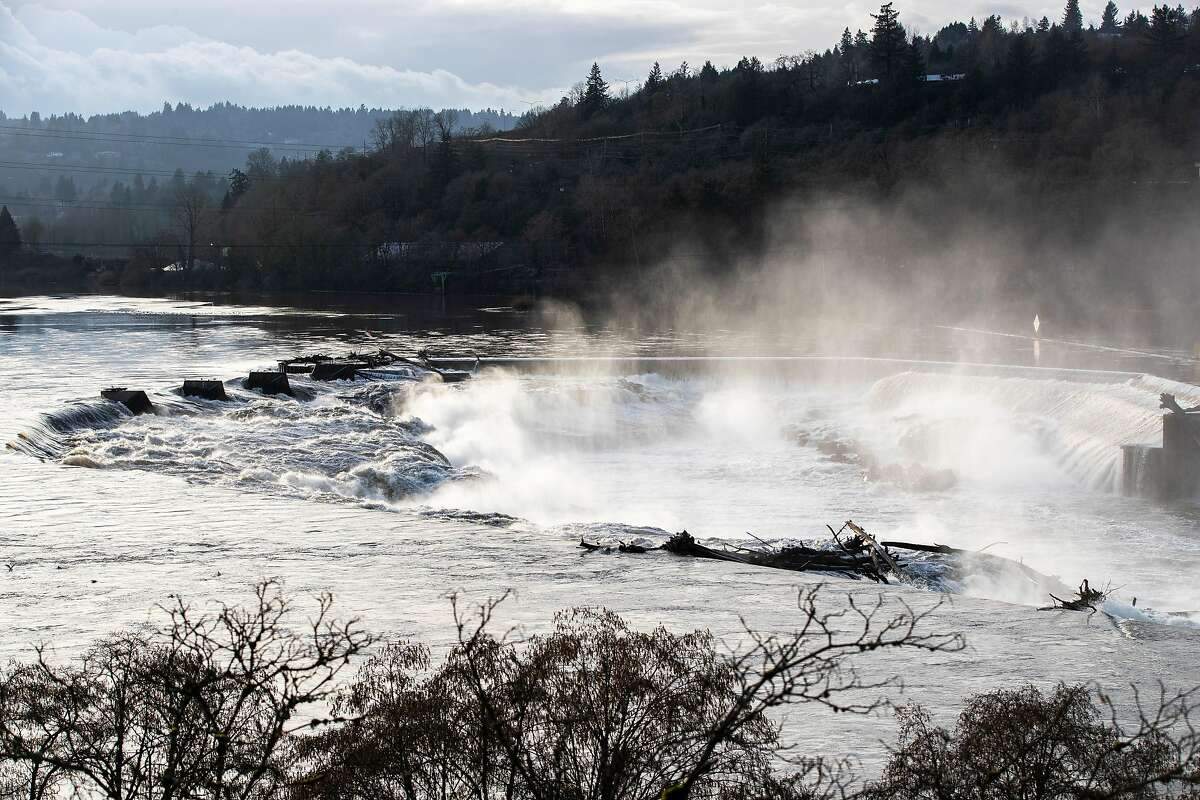 Spray rises from Willamette Falls on Monday, January 21, 2019, in Oregon City, Ore.