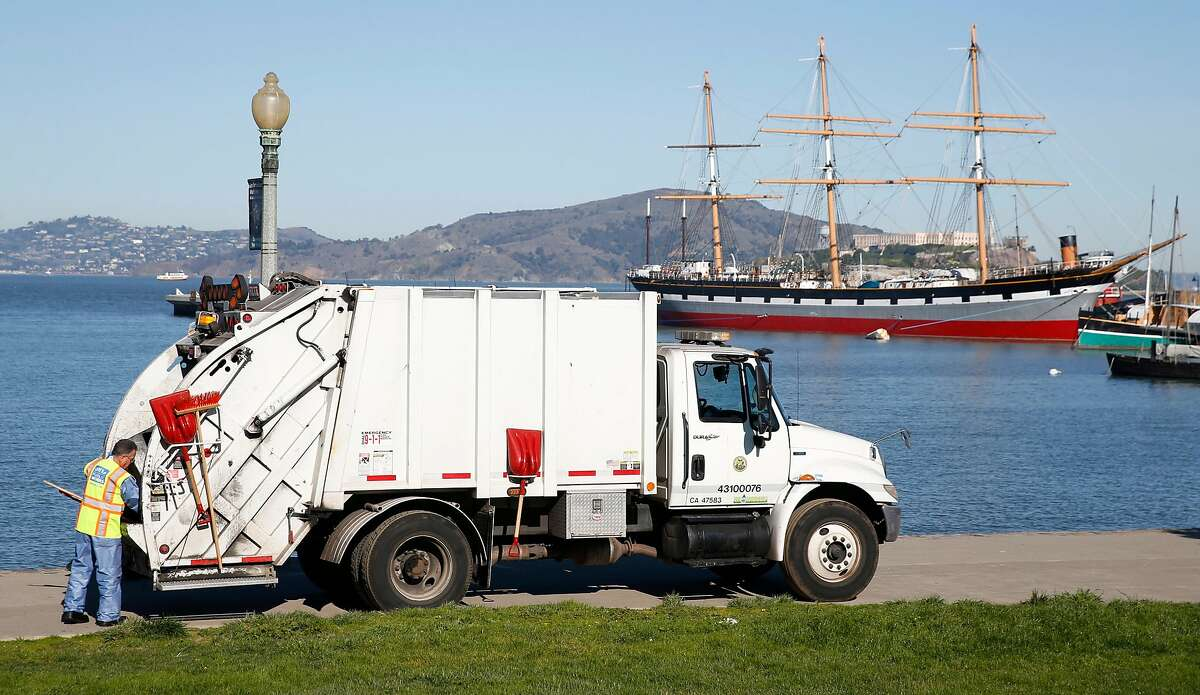 Randy Price and an SF Public Works crew collects trash from Aquatic Park in San Francisco, Calif. while National Parks Service employees remain furloughed while the partial federal government shutdown continued on Friday, Jan. 25, 2019. However, the crew learned of President Trump's agreement to end the shutdown as they were cleaning up the park.