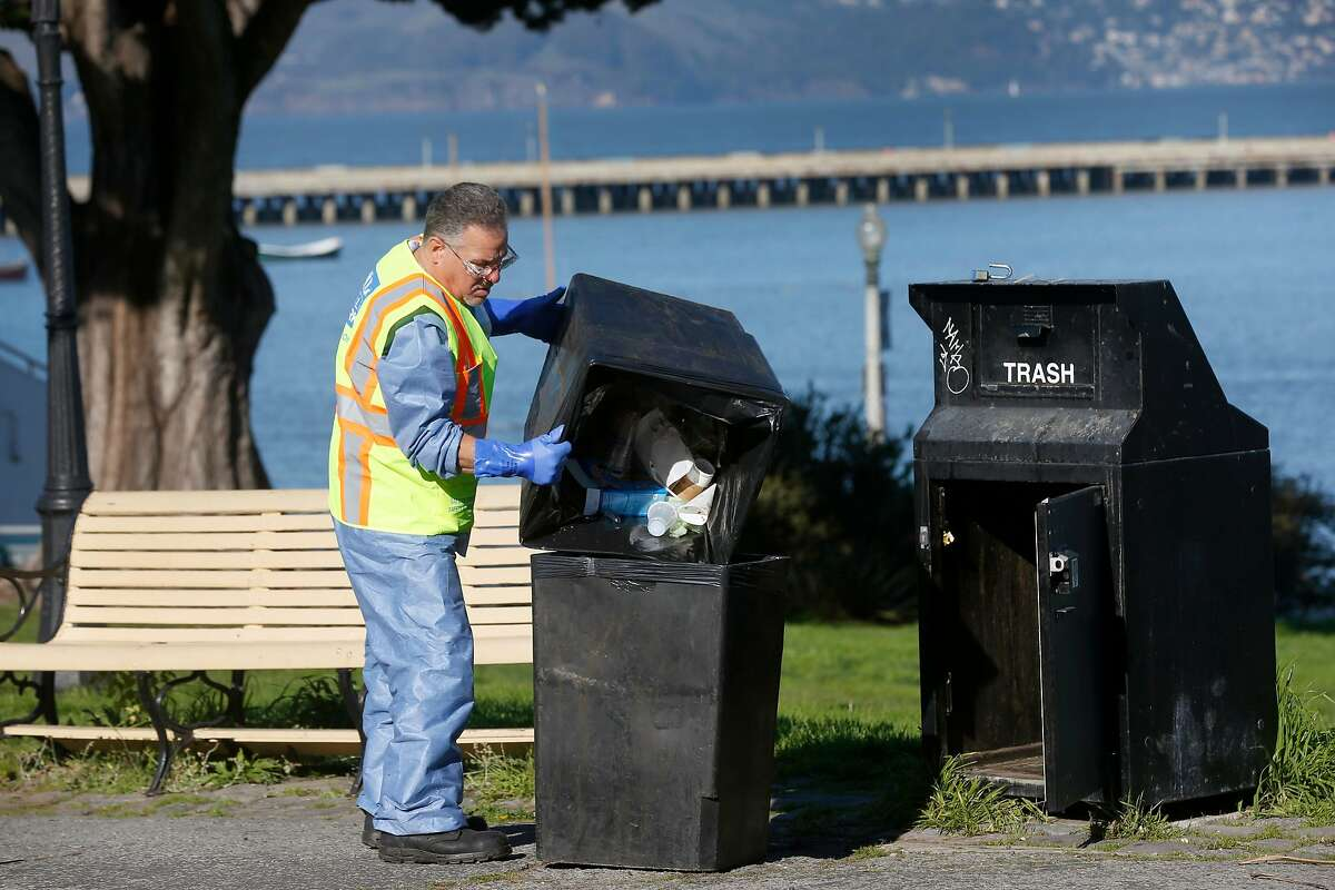 Randy Price with SF Public Works removes trash from Aquatic Park in San Francisco, Calif. while National Parks Service employees remain furloughed while the partial federal government shutdown continued on Friday, Jan. 25, 2019. However, the crew learned of President Trump's agreement to end the shutdown as they were cleaning up the park.