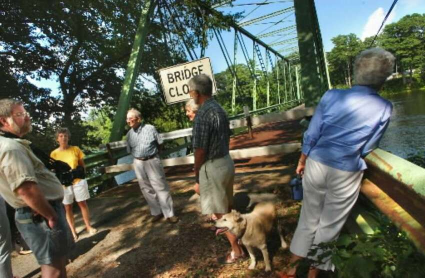 Artists and curators who support the preservation of Dix Bridge in Schuylerville gather about the bridge in 2003. The Saratoga County Board of Supervisors this week voted to renovate the 110-year-old bridge for pedestrian use. (Times Union archive)