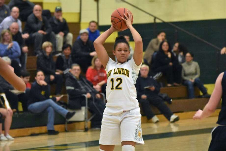 New London's Olivia Yard looks to make a pass vs. East Haven at New London on Tuesday, December 18, 2018. Photo: Pete Paguaga, Hearst Connecticut Media