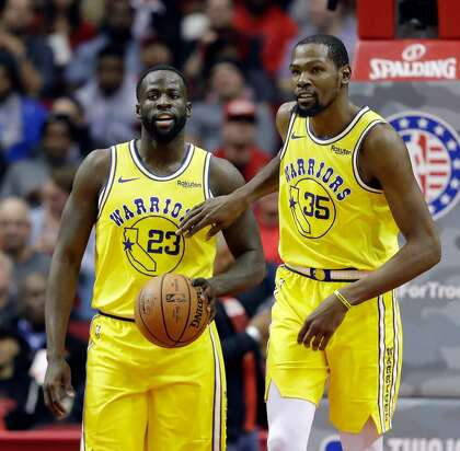 4147b8dc4287 Golden State Warriors  Kevin Durant (35) pats Draymond Green (23) on the  chest after a turnover during the second half of an NBA basketball game  against the ...