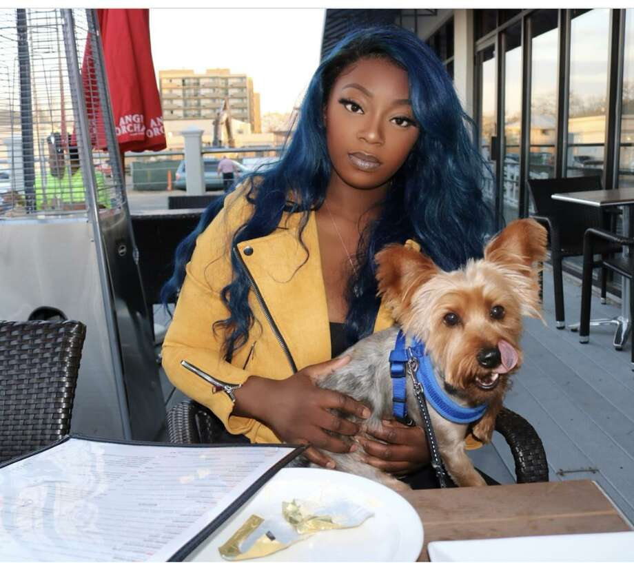 Roshaun Henry and her dog Harlem, who police say was taken this week from outside the Stop & Shop on Stamford's West Side. Photo: Contributed Photo